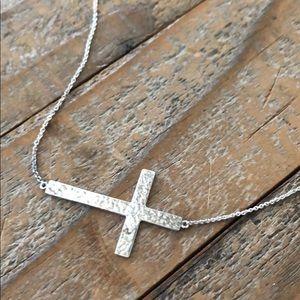 silver, sideways cross necklace.